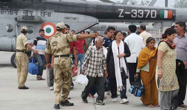 Rescued people arrive at Jolly Grant airport, in Dehradun, Uttarakhand. Image courtesy PIB