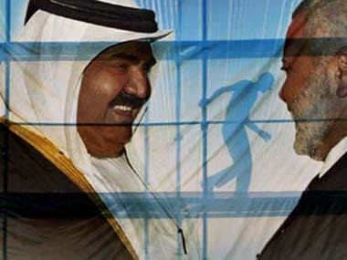 A poster of the Emir of Qatar Hamad bin Khalifa Al Thani. AP image