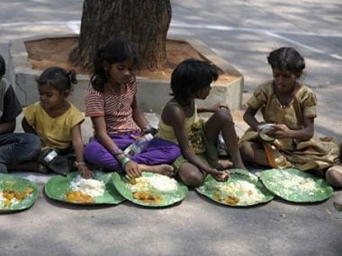 File photo of Indian homeless eating food at a feeding programme for the poor in Hyderabad. AFP