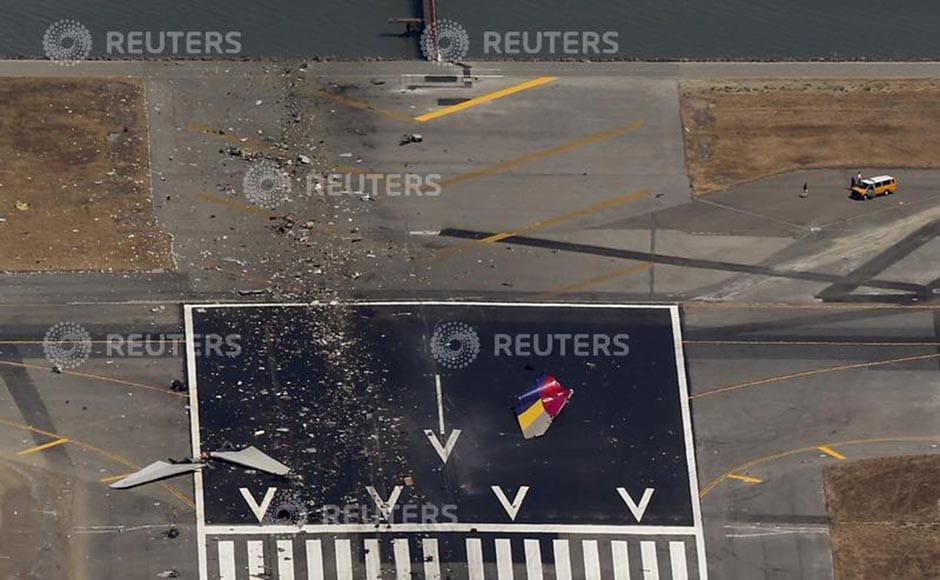 Debris from an Asiana Airlines Boeing 777 plane is seen on a runway after it crashed while landing at San Francisco International Airport in California. Jed Jacobsohn /Reuters