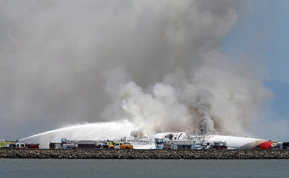 Emergency responders work at the site of the crash of Asiana Flight 214 at San Francisco International Airport in San Francisco. John Green/Bay Area News Group/Associated Press