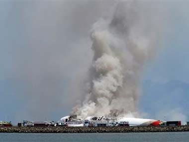 Smokes rises from Asiana Flight 214 after it crashed at San Francisco International Airport: AP