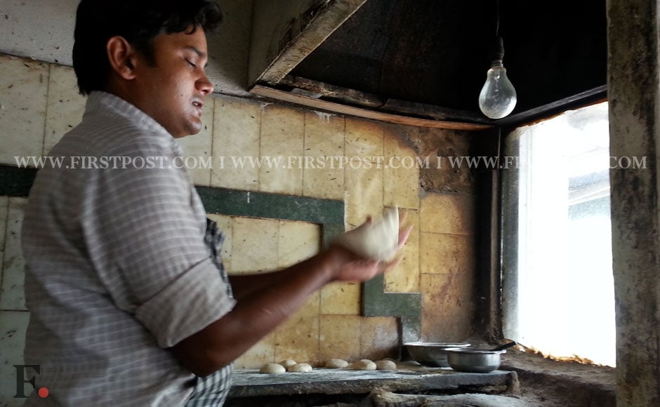 Punjab Restaurant, Aurobindo Marg, New Delhi: Free: A glass of water, Rs. 1: nothing, Rs. 5: 200ml bottled water, Rs. 12: Two plain tandoori rotis. Seen here, an employee of the restaurant makes tandoori rotis. Arlene Chang/Firstpost.