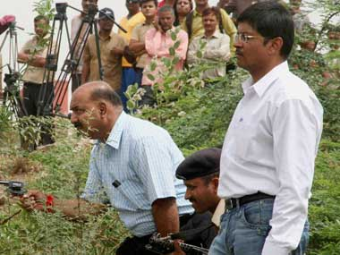 File photo shows suspended police officers Tarun Barot (holding revolver) and G.L Singhal (R) during a reconstruction of Ishrat Jehan encounter by CBI.  PTI