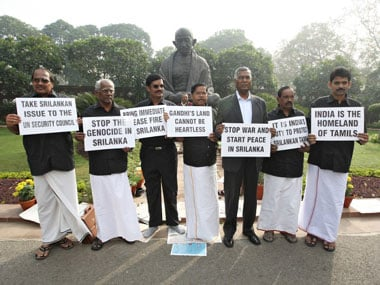 PMK MPs protest UPA's stand on Sri Lanka. AFP.