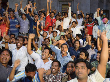 Students of Osmania University celebrate the formation of Telangana. AFP