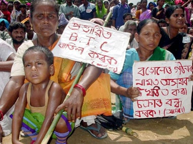 Assamese people protesting the formation of Bodoland. AFP.