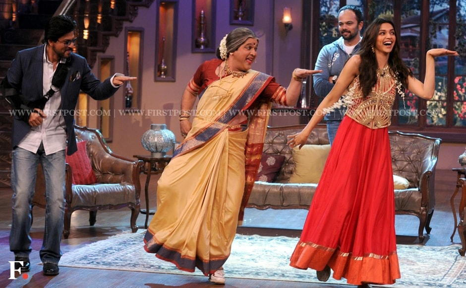 Is it a duck? Is it Walk-Like-An-Egyptian day? No, that's just Shah Rukh Khan and Deepika Padukone shaking one leg each. You've got to wonder how weird a dance is when even Rohit Shetty isn't amused. Sachin Gokhale/Firstpost