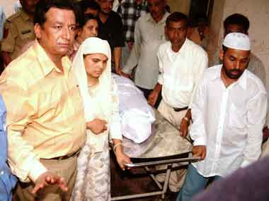 Ishrat Jahan's mother with the body of her daughter. AFP