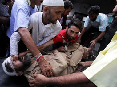 A man injured during the BSF shooting in J&K. AFP.
