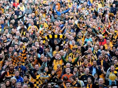 Hull City fans celebrate after winning promotion to the EPL. Getty Images