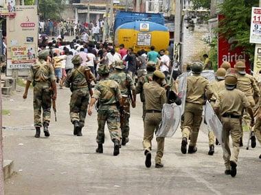 The police turning back protesters in Kishtwar: PTI
