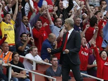 Arsenal's manager Arsene Wenger reacts to their win against Tottenham Hotspur. AP