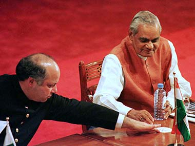 Pakistani Prime Minister Nawaz Sharif passes a coaster to his Indian counterpart Atal Behari Vajpayee July 29 during the opening ceremony of the three-day summit of the South Asian Association for Reginoal Coperation (SAARC). Reuters