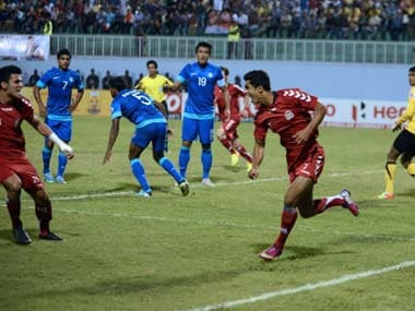 Afghanistan players celebrate after scoring a goal while India players slump. AFP
