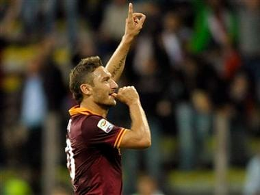 AS Roma's Francesco Totti celebrates after scoring during a Serie A soccer match between AS Roma and Parma. AP