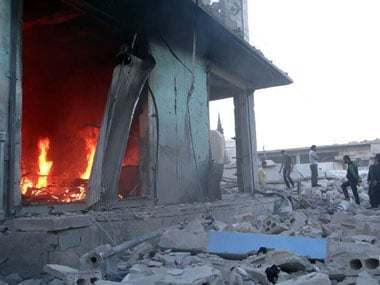 A building on fire in Syria. Agencies.