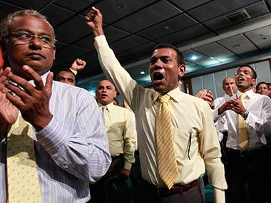 Former Maldivian president Mohamed Nasheed cheers as he arrives at a Maldivian Democratic party meeting in Male in this file photo.