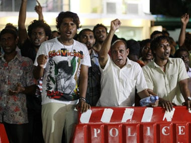 Supporters of Maldives former President Mohamed Nasheed shout slogans near the Supreme Court in Male. AP