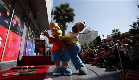 Watch more of Homer and Bart: The Simpsons renewed for 26th season