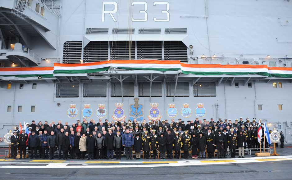 A group photo of all dignitaries of India and Russia on board INS Vikramaditya, at Sevmash Shipyard in Russia on 16 November 2013. Image courtesy PIB