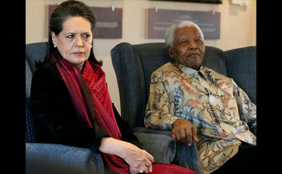 Former South African president and Nobel peace prize laureate Nelson Mandela with Sonia Gandhi, the President of the Indian National Congress and the leader of the ruling Indian Congress Alliance at the Mandela Foundation in Johannesburg during her four day working visit to South Africa. Gandhi presented a smiling Mandela with a book entitled 'Gandhi's Way' which celebrated a centenary of Mahatma Gandhi's philosophy of peace and humanity. AFP