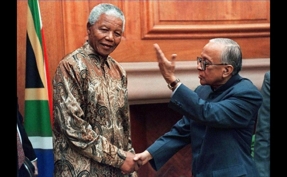 Jyoti Basu, Former Chief Minister of West Bengal, meets South African President Nelson Mandela at his office in Pretoria 22 July. AFP