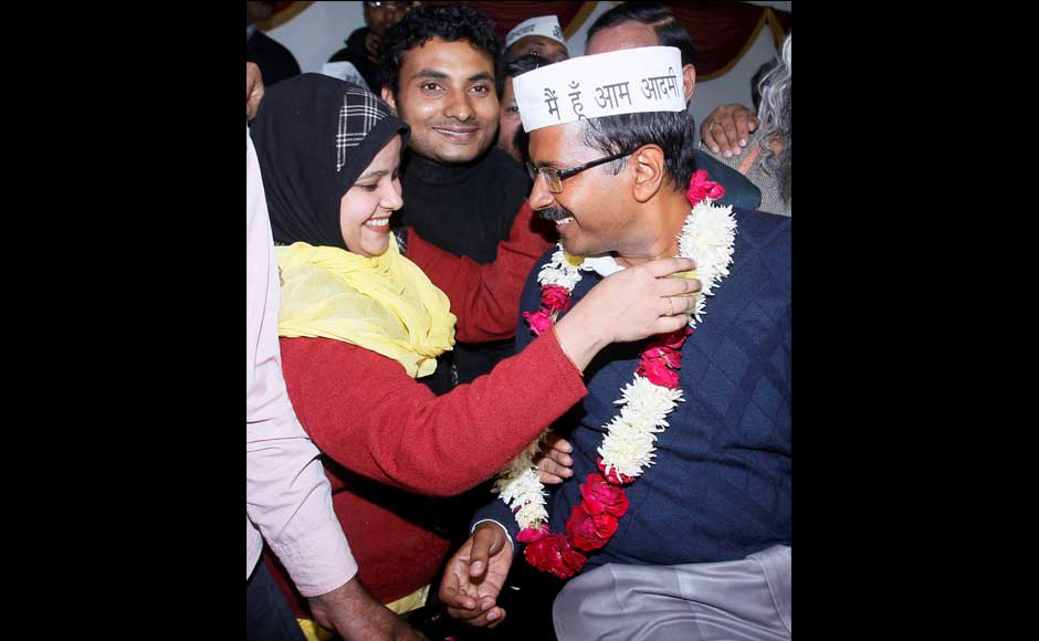 Aam Aadmi Party convener Arvind Kejriwal being garlanded by a party worker after he was elected unanimously by 27 legislators of the Aam Aadmi Party as their leader in the Delhi Assembly, in New Delhi on Monday. PTI