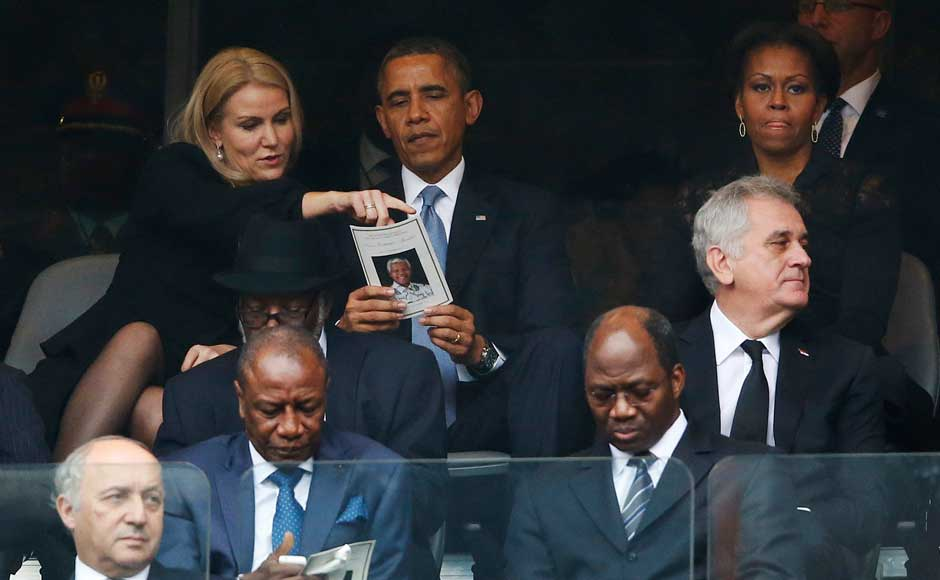 US President Barack Obama talks with Danish Prime Minister Helle Thorning-Schmidt, left, as US first lady Michelle Obama looks on at right during the memorial service for former South African president Nelson Mandela at the FNB Stadium in Soweto, near Johannesburg, South Africa. AP