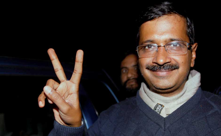 Aam Aadmi Party convener Arvind Kejriwal flashes victory sign as he arrives for a meeting with party newly elected representatives on Monday.PTI