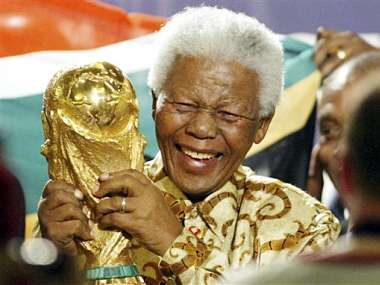 n this May 15, 2004 file photo, former South African President Nelson Mandela lifts the World Cup trophy in Zurich, Switzerland, after FIFA's executive committee announced that South Africa would host the 2010 FIFA World Cup. AP