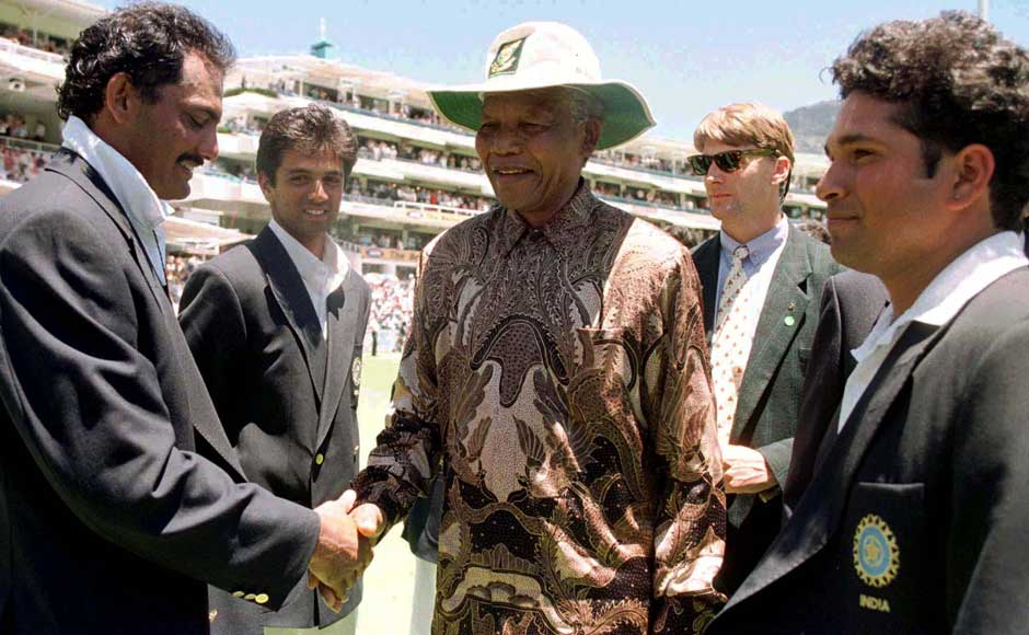 South African President Nelson Mandela (C) introduced to Mohammad Azharudin (L) by the Indian captain Sachin Tendulkar (R) January 4. Mandela meet both teams during the lunch break on the third day of the second cricket Test match between South Africa and India at the Newlands cricket ground. Reuters