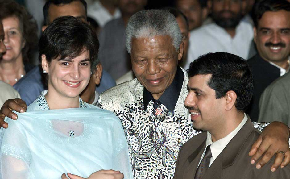 Former South African president Nelson Mandela hugs Priyanka Gandhi, daughter of Congress party president Sonia Gandhi, and her husband Robert Vadra after receiving the Gandhi Peace Prize in New Delhi March 16, 2001. Mandela received the 10-million rupees ($217,391) Gandhi Peace Prize for his non-violent resistance to apartheid. Reuters