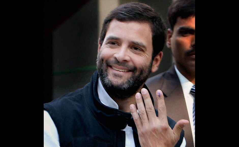 Congress Vice President Rahul Gandhi shows his ink-marked finger after casting his vote for Delhi Assembly elections at a polling station in New Delhi on Wednesday. PTI
