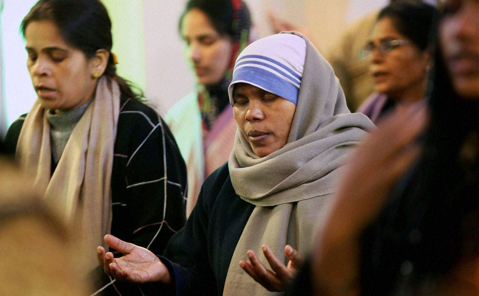 2 7 Devotees Pray At Holy Family Catholic Church On The Occasion Of Christmas In Srinagar Wednesday