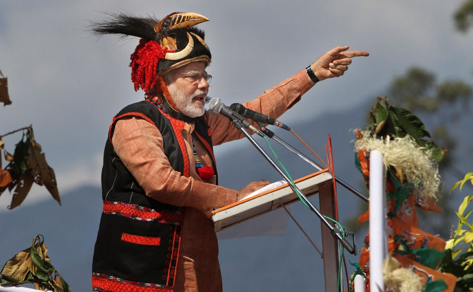 Narendra Modi addresses a gathering at a public rally in Pasighat, Arunachal Pradesh. He's wearing a traditional dumluk which the headgear of the Adi tribe. AP