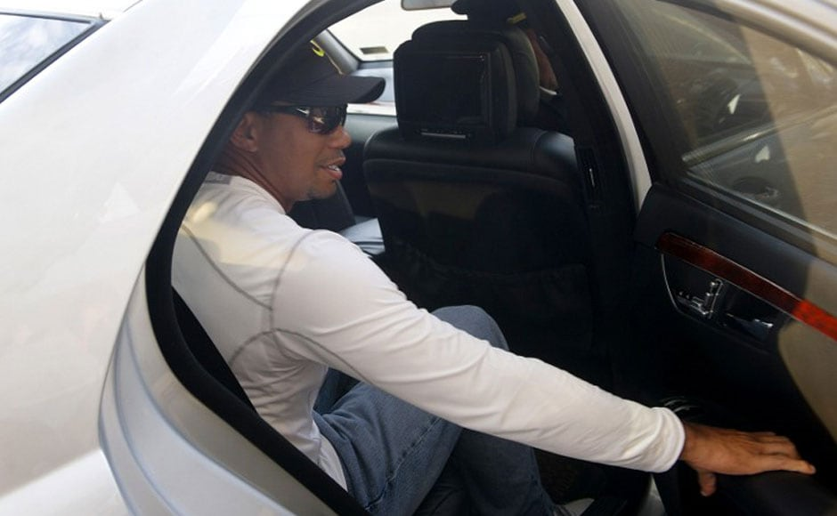 US golfer Tiger Woods gets into car as he leaves the International airport on his arrival in New Delhi. AFP