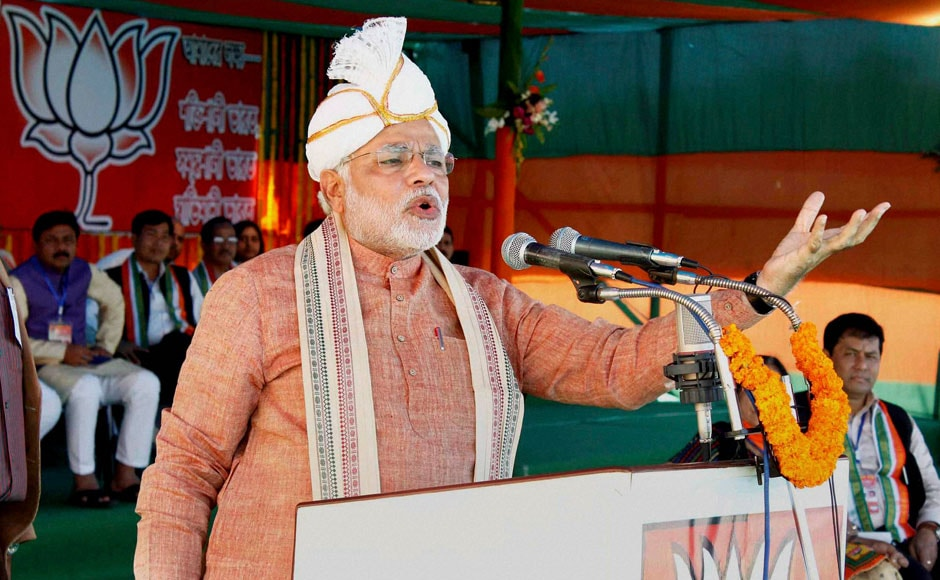 "BJP Prime Ministerial candidate Narendra Modi addressing ""Barak Bikash Samabesh"" rally at Ramnagar in Silchar, Assam on Saturday. He's wearing a traditional Koyet turban in this picture. PTI"