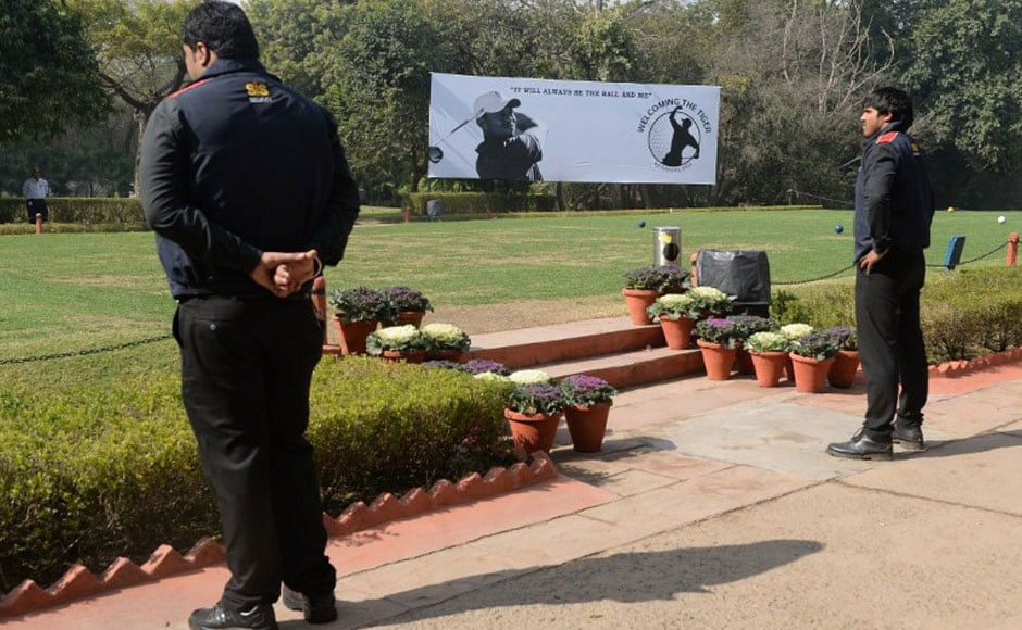 Officials walk past a billboard featuring a silhouetted image of US golfer Tiger Woods at The Delhi Golf Club in New Delhi. One of India's leading golfers believes Tiger Woods short visit next week to Delhi will generate a long-lasting interest in golf. AFP