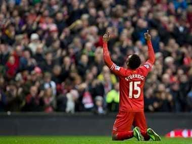 Liverpool's Daniel Sturridge celebrates after scoring his second goal against Swansea City. AP