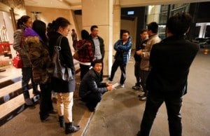 Chinese relatives of passengers aboard a missing Malaysia Airlines plane wait outside a hotel in Beijing Sunday. AP