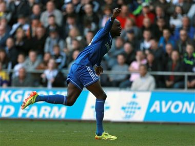 Chelsea's Demba Ba celebrates after scoring his team's opening goal during their English Premier League soccer match against Swansea City at the Liberty Stadium, Swansea. AP