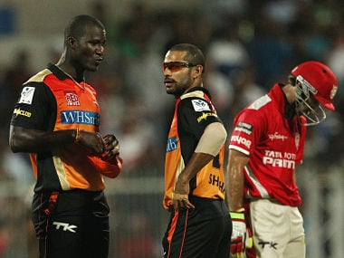 Darren Sammy and Shikhar Dhawan captain of the Sunrisers Hyderabad talk tactics as Glenn Maxwell of the Kings X1 Punjab walks by. BCCI