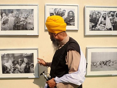 File image of a Sikh man looking at photos of the 1984 riots. AFP
