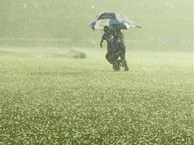 Groundsmen run to cover the pitch as it rains during the ICC Twenty20 Cricket World Cup semifinal match between Sri Lanka and West Indies. AP