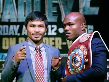 FILE - In this Feb. 6, 2014 file photo, boxer Manny Pacquiao, of the Phillipines, left, poses for a photo with current WBO World Welterweight champion Timothy Bradley of Indio. AP