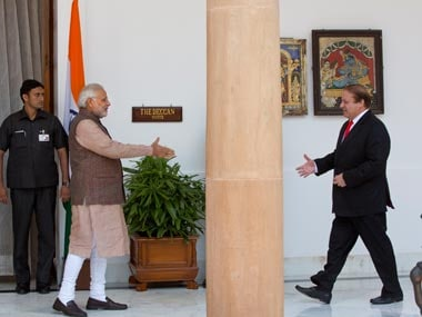 Nawaz Sharif and Narendra Modi ahead of the meet. AP
