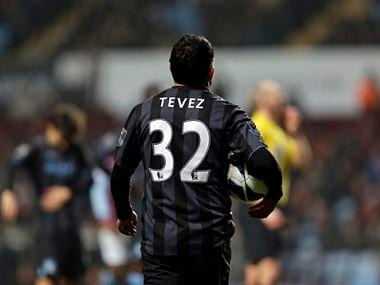 Carlos Tevez doesn't play as hard for Argentina as he does for his club teams. AP