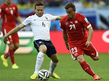 France's Cabaye fights for the ball with Switzerland's Shaqiri  during their 2014 World Cup Group E soccer match at the Fonte Nova arena in Salvador