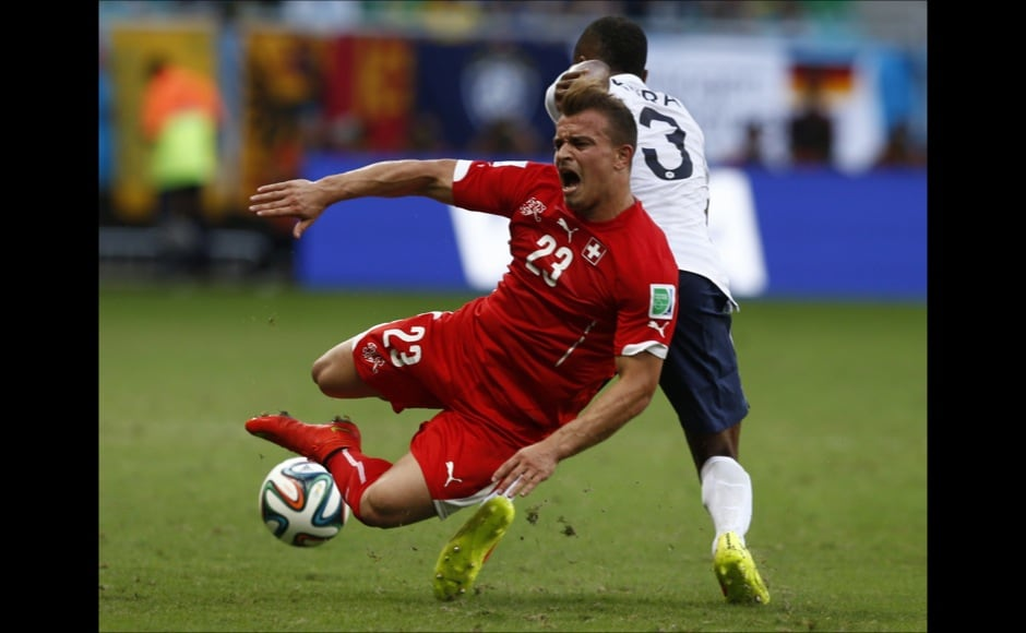 Switzerland's Shaqiri is fouled by France's Evra during their 2014 World Cup Group E soccer match at the Fonte Nova arena in Salvador
